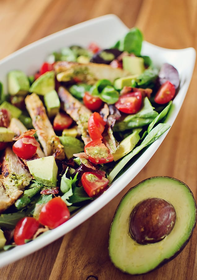 Chicken BLT Salad with Citrus Tomatillo Dressing served with avocado