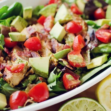 Chicken BLT Salad with Citrus Tomatillo Dressing served in large bowl