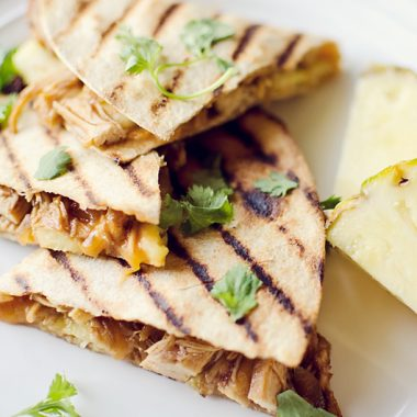 Crock Pot BBQ Chicken Pineapple Quesadillas on plate with slices of pineapple