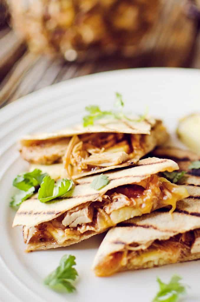 Crock Pot BBQ Chicken Pineapple Quesadillas on plate garnished with cilantro