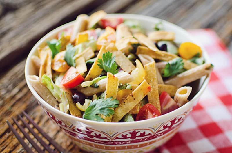 Southwest Penne & Romaine Salad in fiesta bowl on table