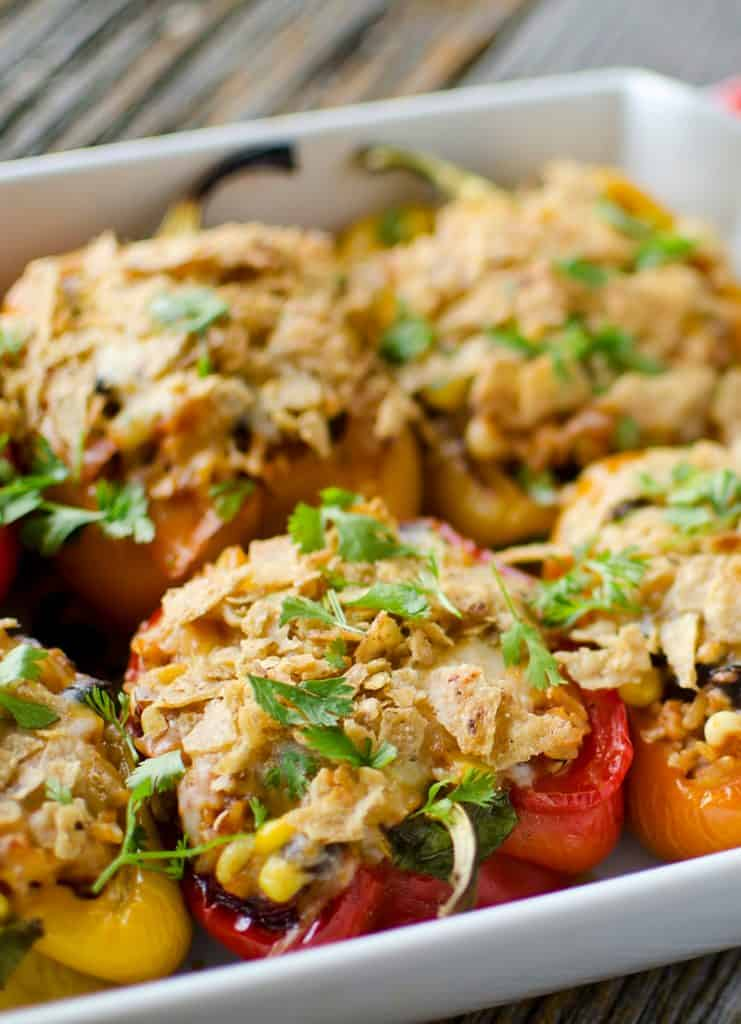 Light Chipotle Chicken & Rice Stuffed Peppers are loaded with lean ground chicken, brown rice, black beans, corn and chipotle salsa and are topped with melted cheddar and crunchy tortilla chips!