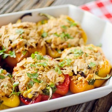 Light Chipotle Chicken & Rice Stuffed Peppers in baking dish served on table