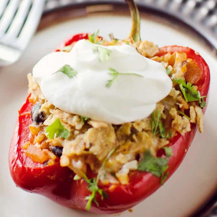 Light Chipotle Chicken & Rice Stuffed Peppers on plate topped with greek yogurt