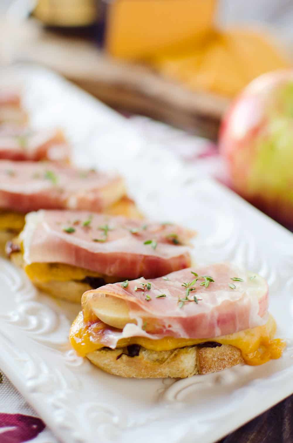 caramelized-onion-and-cheddar-crostinis-with-prociutto-wrapped-apples-appetizer