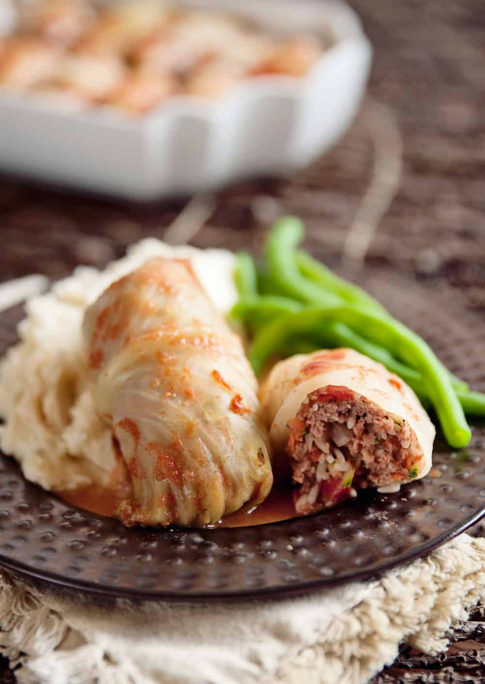 Beef, Rice & Vegetable Stuffed Cabbage Rolls are an old comforting dinner recipe made healthier with the addition of lots of vegetables!