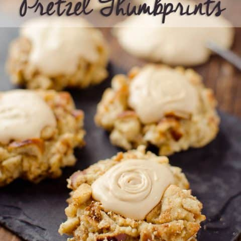 Salted Caramel Pretzel Thumbprint Cookies - Krafted Koch - A fantastic cookie recipe that will impress your guests with a dense, but moist cookie rolled in crunchy pretzels and topped with rich salted caramel frosting!