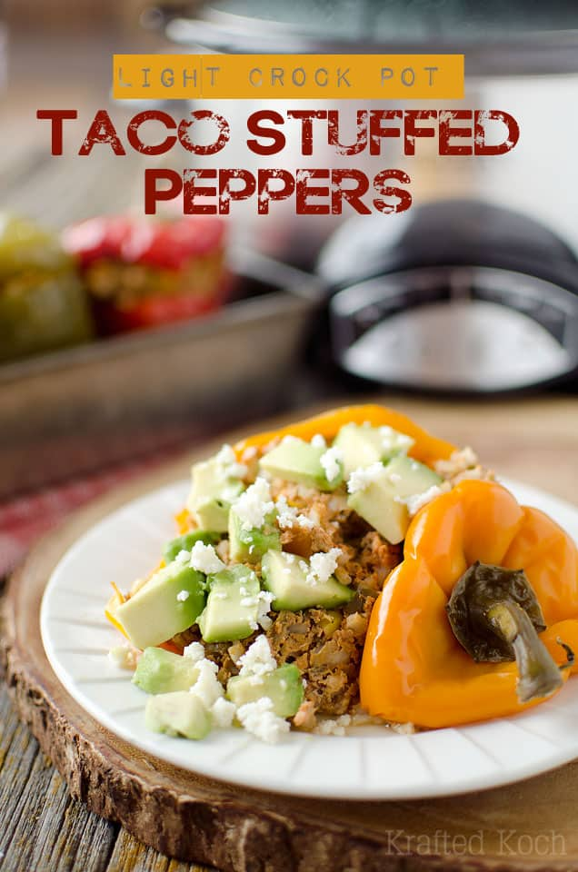 Light Crock Pot Taco Stuffed Peppers - Krafted Koch - An amazingly simple stuffed pepper recipe made in your slow cooker for a healthy dinner idea. #StuffedPeppers #Healthy #Dinner