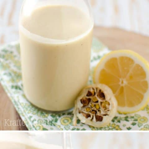 Roasted Garlic & Lemon Dressing - Krafted Koch - A healthy vinaigrette recipe loaded with bold roasted garlic and fresh lemon for the perfect salad dressing. #Vinaigrette #SaladDressing #Healthy #Light #Recipe