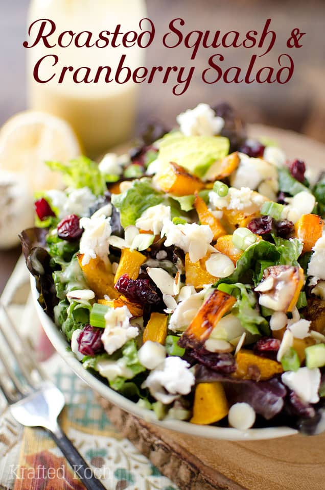 Roasted Squash & Cranberry Salad is a flavorful vegetarian salad loaded with roasted butternut squash, creamy goat cheese, crunchy almonds and dried cranberries with a homemade Roasted Garlic & Lemon Dressing for a healthy dinner that will satisfy all your senses! #Salad #Healthy #Harvest #Vegetarian