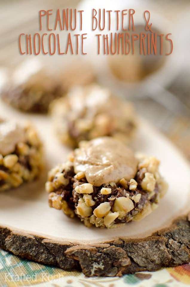 Peanut Butter & Chocolate Thumbprint Cookies - Krafted Koch - A rich chocolate cookie recipe rolled in walnuts and filled with sweet peanut butter frosting for the perfect cookie! #Cookie #Recipe #PeanutButter #Chocolate