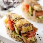 Fried Goat Cheese & Heirloom Tomato Toasts - An amazing meal you can enjoy for breakfast, lunch or dinner. This vegetarian recipe is loaded with fried goat cheese, heirloom tomatoes, avocados and balsamic reduction for a fresh meal bursting with flavor. #Vegetarian #Breakfast #Lunch #Dinner