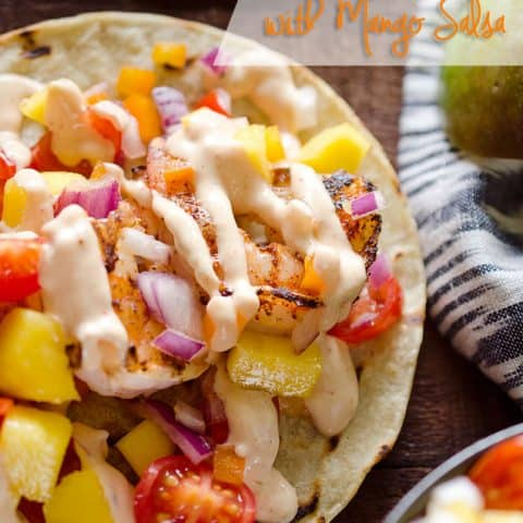 Chipotle Shrimp Tacos with Mango Salsa - A fresh and delicious dinner recipe that can easily be whipped up in 15 minutes for a meal bursting with fresh fruit and vegetables topped with a spicy chipotle sauce. #Tacos #Healthy #Light #DInnerIdea