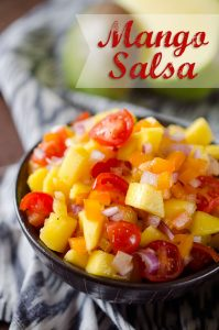 Mango Salsa - A fresh and flavorful pico de gallo recipe made with fresh fruit and vegetables for the perfect summer snack or healthy addition to a grilled chicken breast or steak! #Salsa #Light #PicoDeGallo #Healthy #Snack