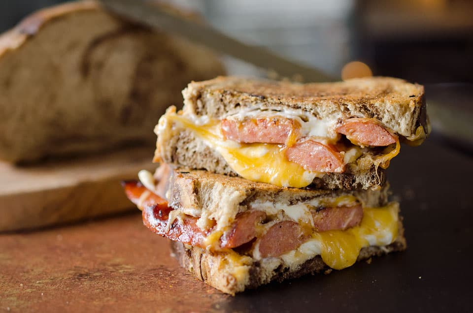 Smoked Sausage Triple Grilled Cheese has juicy sausage and creamy gouda, cheddar and cream cheese layered between two pieces of marble rye bread for a rich and gooey grilled cheese that will blow your mind!