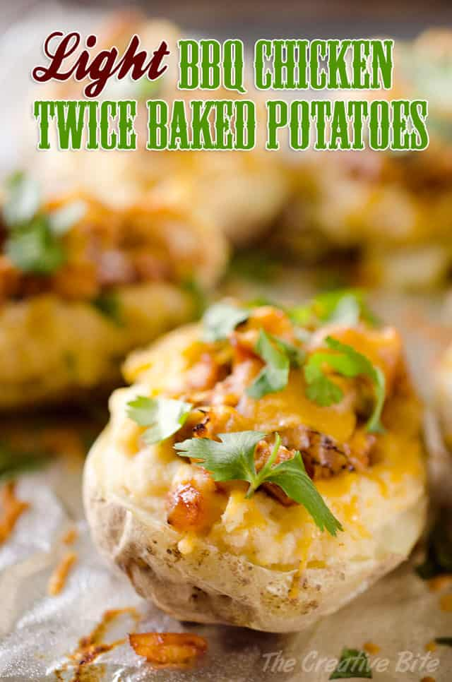 BBQ Chicken Twice Baked Potatoes are a healthy but hearty meal that will have everyone singing your praises. Creamy mashed potatoes with fat free Greek yogurt are topped with BBQ chicken and cheese for a delicious and easy dinner idea. #Light #Healthy #Chicken #TwiceBakedPotatoes #GreekYogurt