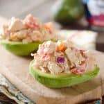 Chipotle Chicken Salad Stuffed Avocados - A low-carb recipe full of fresh vegetables and flavor from a spicy chipotle sauce for a light and healthy packed lunch or dinner idea!