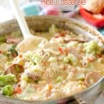 Light Cheesy Chicken, Sausage & Rice Casserole - A creamy chicken and rice bake filled with vegetables and lightened up for a healthy and filling one-pot dinner! #Light #Healthy #chicken #Sausage #Rice #Cheesy