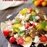 Light Chicken Verde Nachos are a healthy appetizer or fun dinner idea with a pile of baked corn tortillas topped with chicken breasts in a salsa verde and fresh tomatoes and queso fresco. #Light #Chicken #Healthy #Nachos