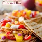 Mango BBQ Chicken Quesadillas are an easy dinner idea bursting with bold flavors from homemade Mango BBQ Sauce and topped with fresh Mango Salsa #Mango #Chicken #Quesadilla #Easy