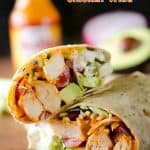 Healthy Buffalo Chicken Wrap - A light and healthy wrap filled with buffalo chicken breasts, Greek yogurt, bleu cheese crumbles, broccoli slaw, avocado and tomatoes for an easy lunch with bold flavor! #Buffalo #Chicken #Wrap #Lunch #Healthy #Light