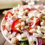 Strawberry & Coconut Cashew Salad is a fresh and healthy dinner salad recipe with ripe strawberries, red onions, goat cheese and coconut cashews. #Salad #Entree #Dinner #Light #Healthy