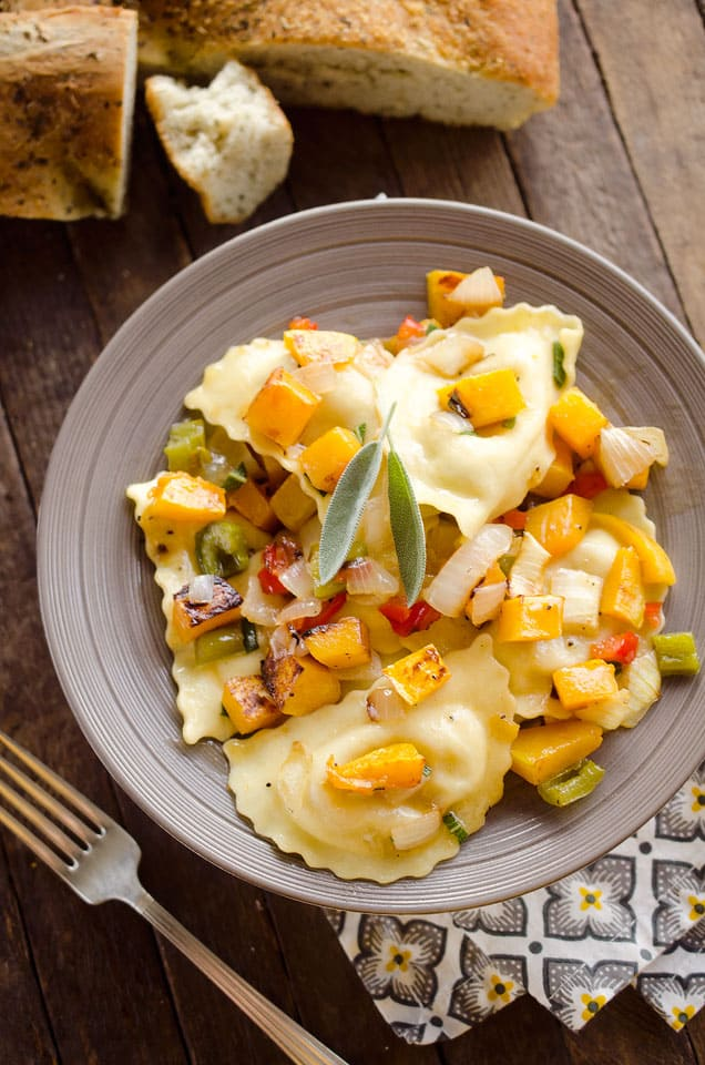 Roasted Squash & Sausage Ravioli is easy weeknight comfort food with roasted butternut squash, onions and bell peppers tossed with sausage ravioli and a butter sage sauce. #Squash #Sausage #Pasta #ComfortFood #Ravioli