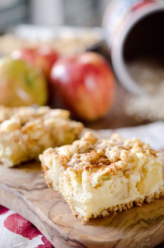 Apple Cheesecake Crumble Bars - This creamy fall treat is full of tart apples and decadent cheesecake with a nutty granola crust for a delicious dessert! #Apple #Bars #Dessert #Cheesecake