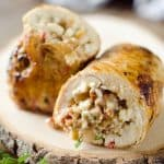 Chicken, Bacon & Feta Roulade is a surprisingly simple dinner idea made with a tender chicken breast wrapped around a bacon, feta, thyme and caramelized onions. #Chicken #Roulade