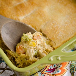 Cheesy Chicken Pot Pie Casserole is a quick and easy weeknight dinner idea with only 5 ingredients! Creamy chicken and vegetables with Campbell's Cheddar Broccoli Chicken Oven Sauce are topped with a flaky crescent crust for a delicious recipe the whole family will love!