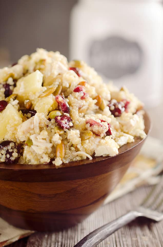Harvest Chicken Quinoa Salad is a healthy and delicious lunch studded with chewy cranberries, juicy pineapple and salty pumpkin seeds along with the tender chicken & protein packed quinoa that are dressed in a homemade pineapple and honey vinaigrette. #Quinoa #Salad #Chicken