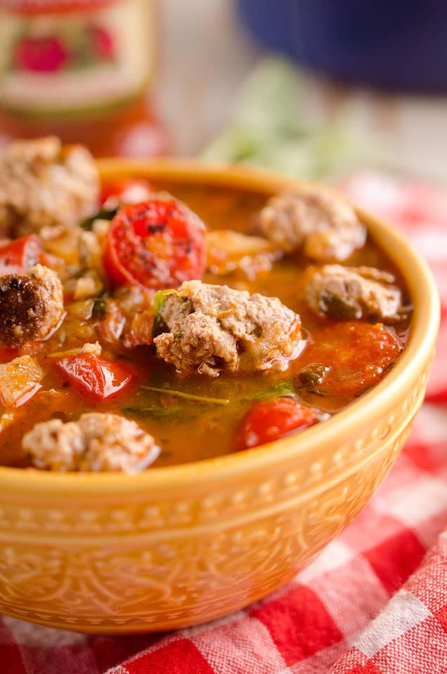 Light Tomato Basil Meatball Soup is a hearty and healthy dinner filled with lean meatballs and fresh tomatoes and basil and will leave you feeling warmed up and satisfied! #Meatball #Soup #Healthy