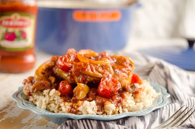 Rustic Italian Chicken Cacciatore is a hearty comfort food, made with Bertolli tomato & basil sauce, red wine and loads of vegetables. Served over brown rice, it is a dinner the whole family will love and you can feel good about! #Chicken #Italian #Rustic #Bertolli #Healthy #TasteOfItaly
