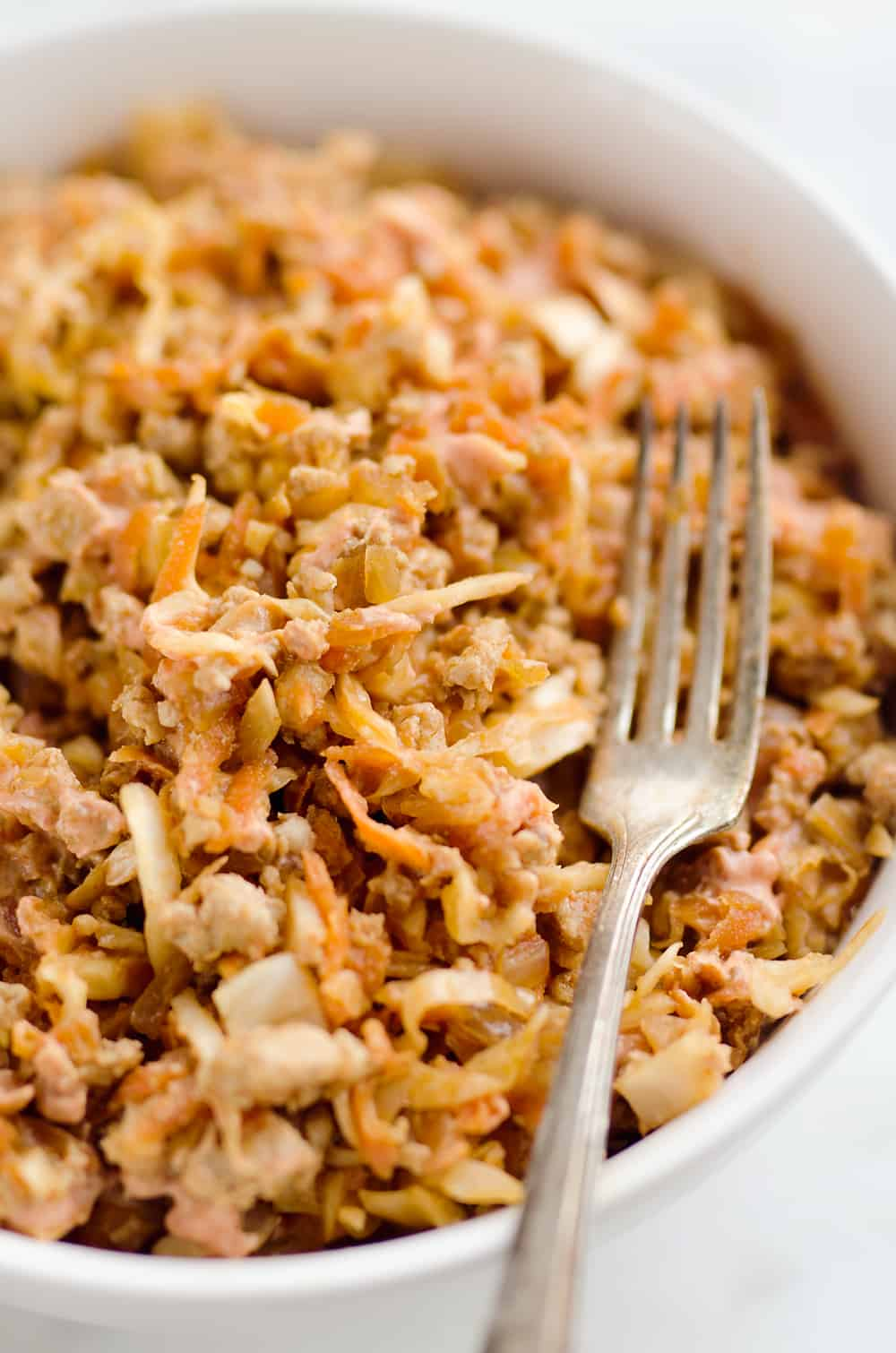 Turkey Egg Roll Bowl with Creamy Sriracha is an amazingly healthy and delicious bowl of goodness perfect for lunch or dinner! Sauteed cabbage, carrots, onion and ground turkey are tossed with an Asian inspired sauce and topped with a creamy Greek yogurt sriracha mayo sauce.