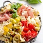 Antipasto Tortellini Pasta Salad is hearty side dish that is a perfect addition to any holiday meal, loaded with prosciutto, salami, Crystal Farms cheese, tomatoes, olives and more!