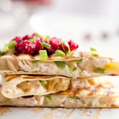 Light Cranberry Turkey Quesadilla are a healthy and easy meal perfect for using up all of that leftover turkey from Thanksgiving! Fill a light tortilla with turkey, havarti cheese and green onions and top it with cranberry salsa for a delicious and unique dinner after the holidays!