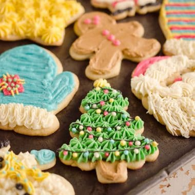 Old Fashion Sour Cream Cut-Out Cookies are the perfect sugar cookie with a cake-like softness and are finished off with the most decadent and delicious buttercream!