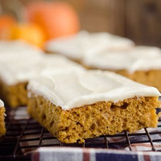 Pumpkin Bars with cream cheese frosting on cooling rack