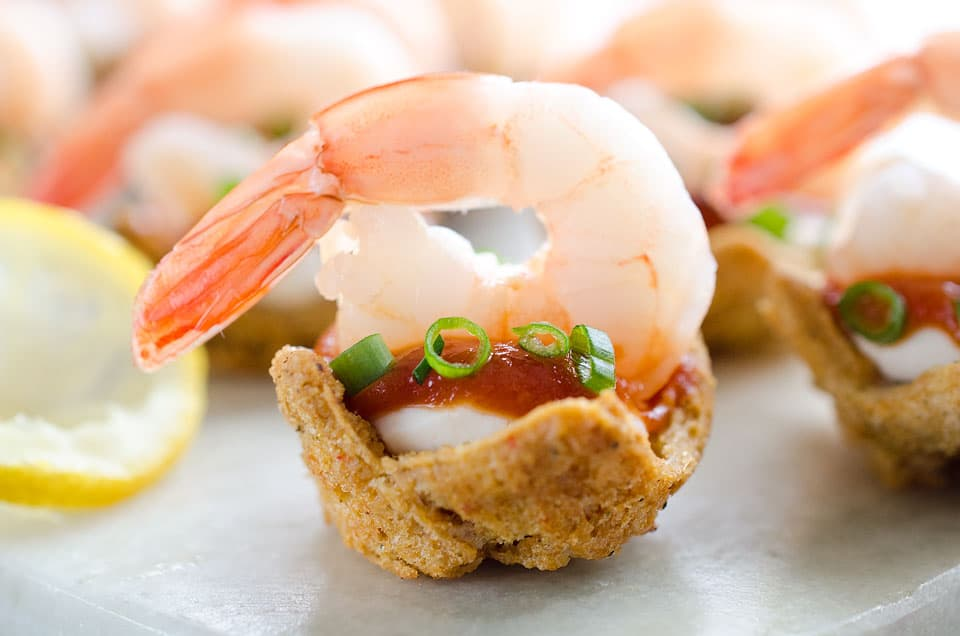 Light Shrimp Cocktail Bites are the perfect finger food to celebrate a holiday party. These individual bites of shrimp cocktail are lightened up with reduced fat cream cheese and Greek yogurt for a delicious and guilt free finger food you can enjoy!