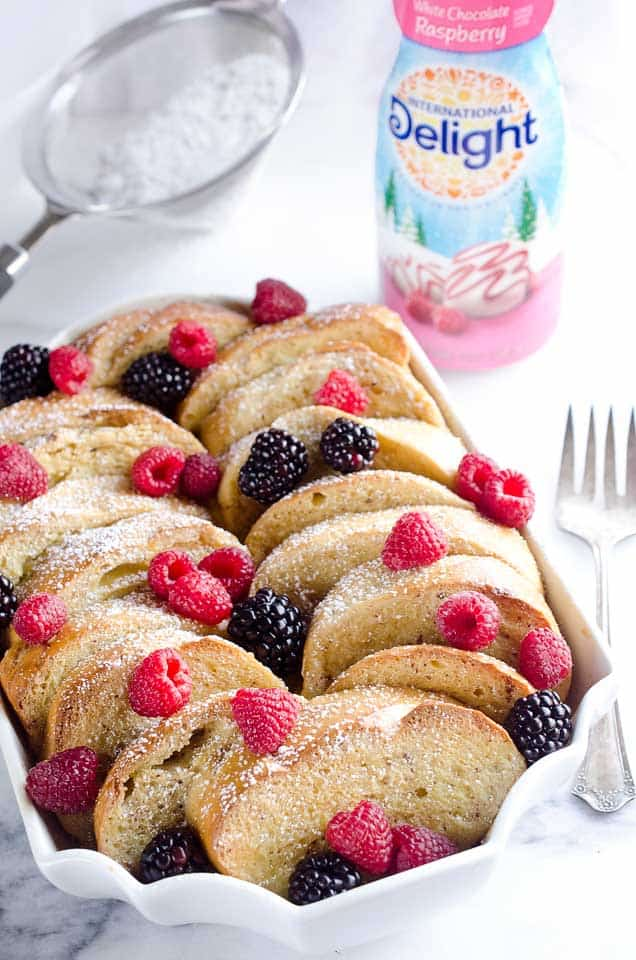 Overnight Berry French Toast Bake is a scrumptious dish so easy to make with a few simple ingredients, including your favorite coffee creamer, International Delight! Throw it together the night before and toss it in the refrigerator so it is ready to bake for your holiday breakfast or brunch!