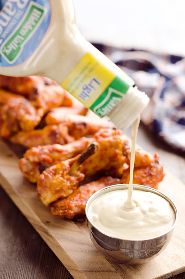 Baked Chipotle Ranch Wings are spicy chicken wings baked to crispy perfection in the oven with a dusting of Hidden Valley Ranch seasoning. These crispy wings are tossed in a delicious chipotle ranch sauce for a a lightened up game day favorite!