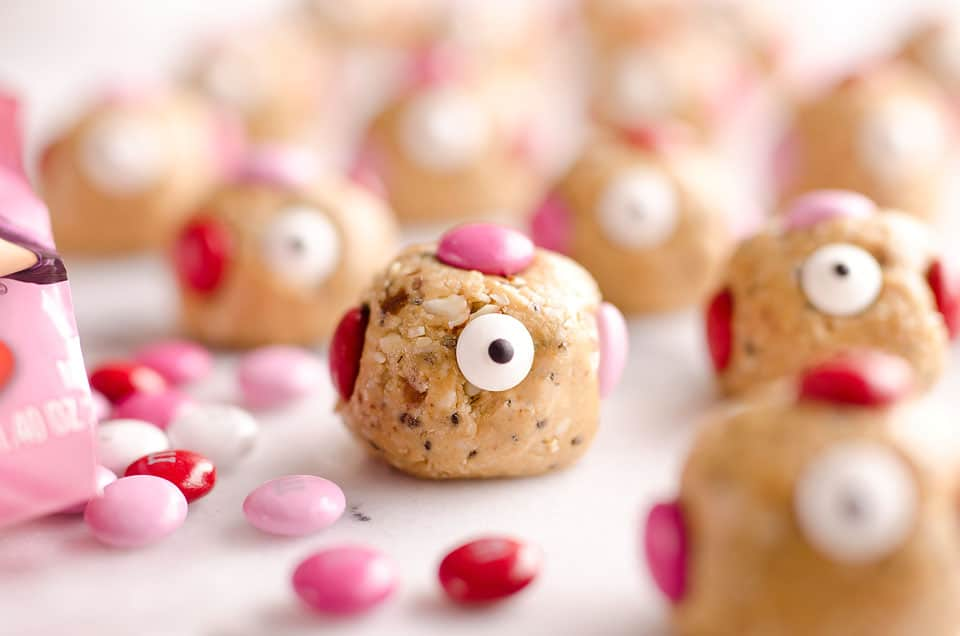 Love Monster Energy Bites are a healthy treat perfect for your Valentine. Kids and adults will love these monsters loaded with peanut butter, chia seeds and almonds with a little bit of chocolate for a protein packed sweet!