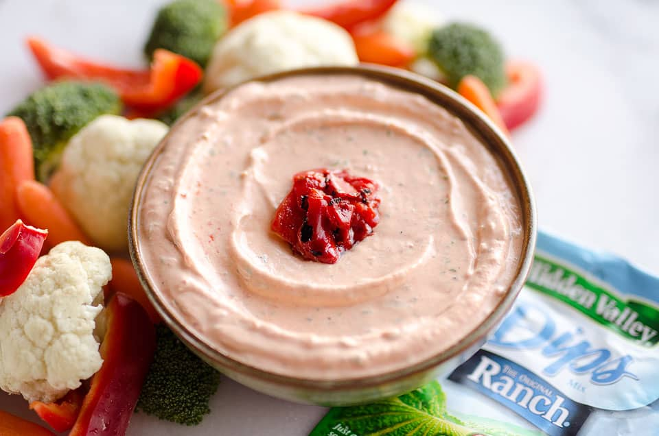 Roasted Red Pepper Ranch Dip is an easy appetizer with light cream cheese, Greek yogurt, and Hidden Valley Ranch, perfect for dipping with your favorite veggies or crackers!