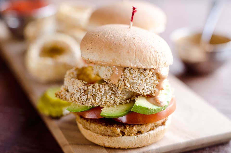 Skinny Cowgirl Veggie Burger is a hearty vegetarian meal loaded with bold flavor and crunch from homemade baked onion rings, smothered in a Greek yogurt and BBQ sauce, all topping your favorite veggie burger.