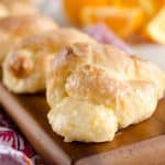 Sweet Roll Orange Knots are an easy and delicious breakfast idea that have all the flavors and light airy texture of a homemade dough, but are made easy with store-bought sweet roll dough!