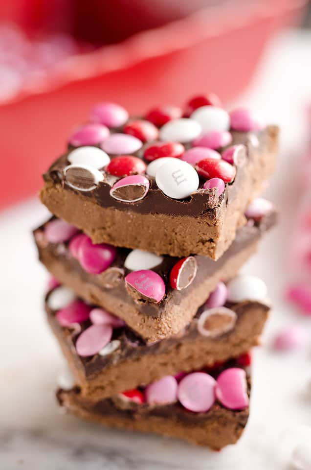Triple Chocolate Peanut Butter No Bake Bars are a delicious dessert recipe ready in only 15 minutes. This sweet treat is perfect for Valentine's day or any time a peanut butter and chocolate craving strikes!