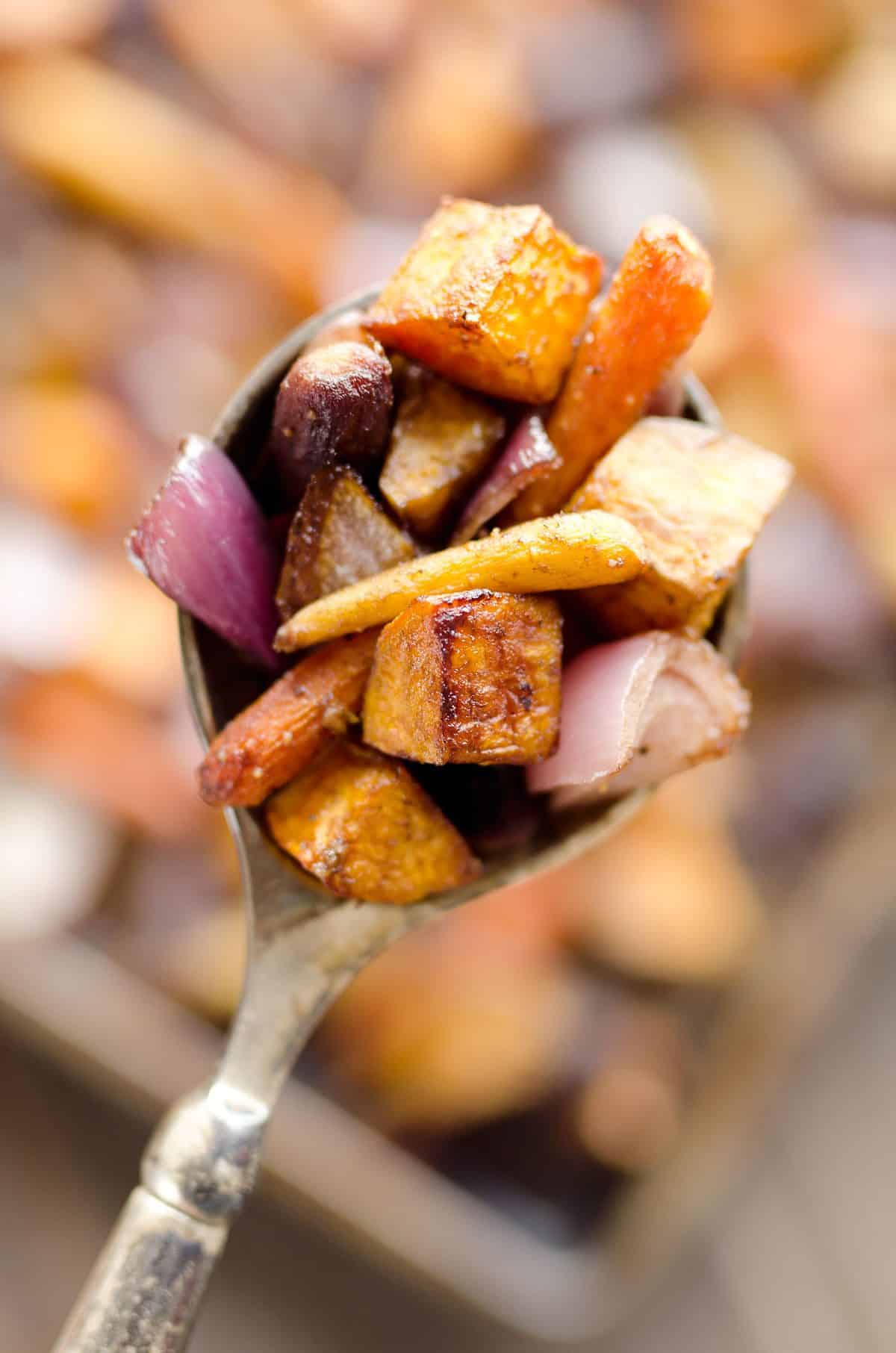 Balsamic Dijon Roasted Root Vegetables is an easy and healthy side dish bursting with tangy balsamic flavor and loaded with sweet potatoes, carrots and onions.