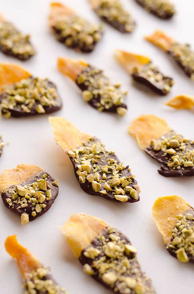 Chocolate & Pistachio Covered Mangoes are an easy and healthy treat to satisfy your sweet tooth! With only 3 simple ingredients, this delicious snack comes together in no time and is perfect for on the go.
