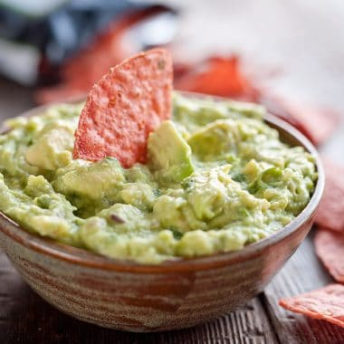 This Easy Guacamole Recipe comes together in minutes and is the perfect dip with salty chips or healthy accompaniment for chicken, shrimp or pork!