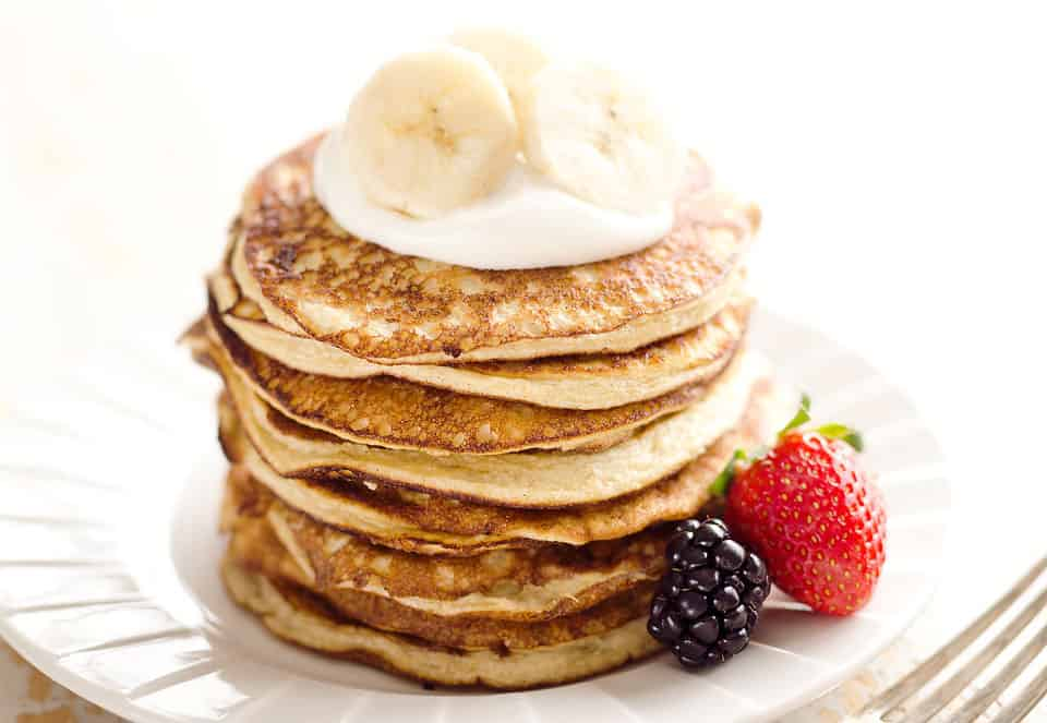 Light & Fluffy Banana Protein Pancakes are a healthy breakfast with five simple ingredients that taste amazing and fill you up! Egg whites, protein powder and ripe bananas make up these low-fat and low-carb pancakes, for a complete and wholesome meal under 200 calories.